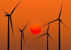 Silhouette wind turbines generating electricity Stock Photography