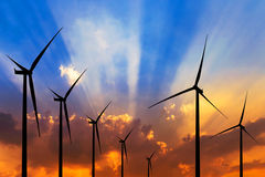 Silhouette wind turbines generating electricity Royalty Free Stock Image
