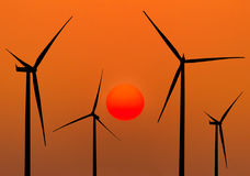 Silhouette wind turbines generating electricity Stock Image