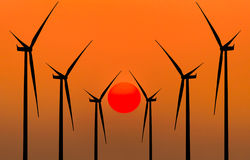 Silhouette wind turbines generating electricity Stock Photo