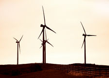 Silhouette of Wind Turbines. Stock Image
