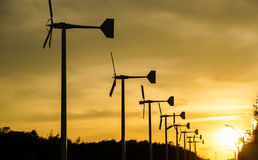 Silhouette of wind turbines. Silhouette of wind turbine row on sunset Royalty Free Stock Photography