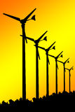 Silhouette Wind turbines on yellow background. Stock Photography