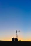 The silhouette of a windmill and buildings Royalty Free Stock Image