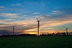 Silhouette of windmill electric power turbine Royalty Free Stock Images