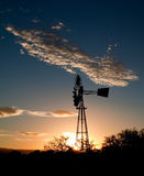 Silhouette of a Windmill at sunset Stock Images