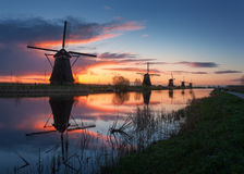 Silhouette of windmills at sunrise in Kinderdijk, Netherlands Royalty Free Stock Images