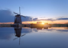 Silhouette of windmills at sunrise in Kinderdijk, Netherlands royalty free stock image