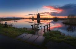 Silhouette of windmills at sunrise in Kinderdijk, Netherlands Stock Image