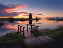 Silhouette of windmills at sunrise in Kinderdijk, Netherlands Stock Images