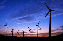 Silhouette of windmills on sunset background Royalty Free Stock Photo
