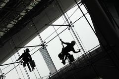 Silhouette  of Window Cleaners Royalty Free Stock Photo