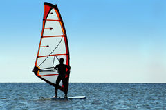 Silhouette of a windsurfer on the sea royalty free stock image