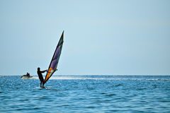 Silhouette of a windsurfer Stock Photos