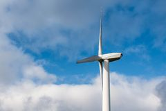 Silhouette of windturbine energy generator on blue cloudy sky at a wind farm in germany Royalty Free Stock Photography
