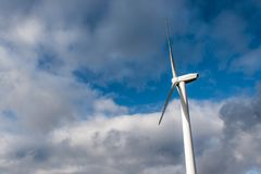 Silhouette of windturbine energy generator on blue cloudy sky at a wind farm in germany Stock Images