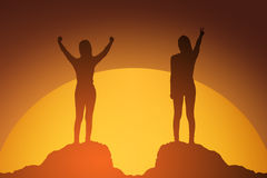 Silhouette of winning success woman at sunset or sunrise standing and raising up her hand in celebration.business success concept. Silhouette of winning success Royalty Free Stock Images
