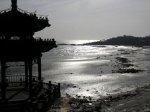 Silhouette in winter. Chinese pavillion silhouetted on a wintery beach in china royalty free stock photo