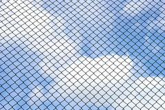 Silhouette wired fence with blur cloud and blue sky Royalty Free Stock Photos