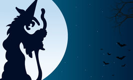 Silhouette of witch and bat Halloween Stock Photo