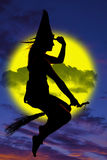 Silhouette of witch on broom Stock Photo
