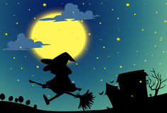 Silhouette witch flying on broom at night Stock Photos