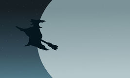 Silhouette of witch flying in moon Royalty Free Stock Photos