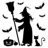Silhouette witch holding broom Stock Photography