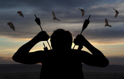 Silhouette of a witch-hunter of arrows Royalty Free Stock Photography