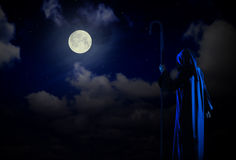 Silhouette of witch. On night sky background Royalty Free Stock Image