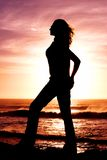 Silhouette of a woman. Silhouette of a woman at sunset on the beach stock image