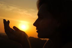 Silhouette woman. Silhouette of a woman on sunset Stock Image
