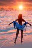 Silhouette of the woman against a sunset at ocean Stock Image