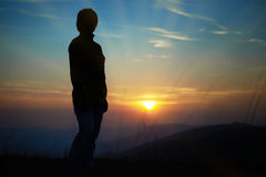Silhouette of woman against sunset Stock Photos