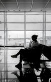Silhouette of woman at airport waiting room Royalty Free Stock Photos