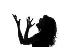 Silhouette woman angry screaming. Portrait silhouette in shadow of a young woman screaming anger  in studio on white background isolated Stock Photography