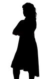 Silhouette of woman with arms crossed Stock Images