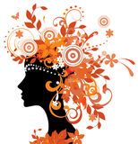Silhouette of woman with autumn leaves Stock Photo