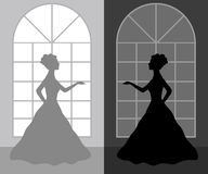 Silhouette woman in a ball dress Royalty Free Stock Photos