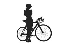 Silhouette of woman with a bicycle Stock Photo