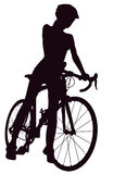 Silhouette of woman with a bicycle Stock Images