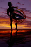 Silhouette of woman with big beach ball Royalty Free Stock Images