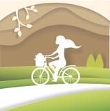 Silhouette of woman on bike. Illustration made of cardboard or paper. art. Vector. Cartoon. Flat stock illustration