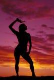 Silhouette of woman in bikini gun over head Royalty Free Stock Photography
