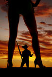 Silhouette woman in bikini heels legs one turned to side cowboy stock photography