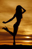 Silhouette woman in bikini stand one leg up Royalty Free Stock Image