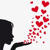 Silhouette woman blowing heart Royalty Free Stock Photography