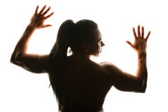 Silhouette of woman bodybuilder from back Royalty Free Stock Image