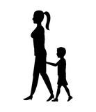 Silhouette woman and boy son walking Royalty Free Stock Photos