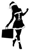 Silhouette of a woman in a Christmas outfit Stock Photos